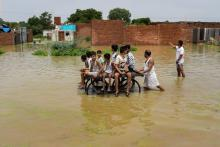 Day in Photos - August 2: Yamuna Floods; BWF World Championships; TDP Protest