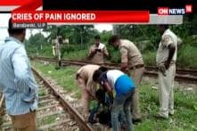 Watch: Police Drags Man From Railway Tracks