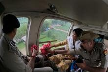 Govt. Officials, Cops Shower Flowers on Kanwarias From Helicopter