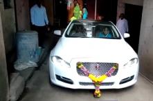 Pune Farmer Buys Jaguar XJ Worth Rs 1.1 Crore, Celebrates with Rare Gold Leafed Sweets [Video]