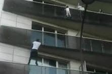 Father of French Boy Whose Dramatic Rescue from Balcony Made Headlines in May Charged with Negligence