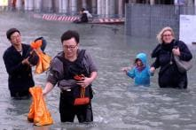 Rains Submerge Italy's Venice City, Bringing Life To A Standstill