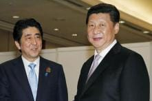 Japan PM Shinzo Abe Welcomed Near Tiananmen Square in Rare China Visit