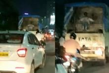 WATCH: Man Rides Swing in the Back of a Moving Truck in Mumbai Traffic