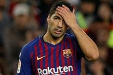 Barcelona's Luis Suarez to Miss Two Weeks for Knee Treatment