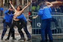 Topless Protester Blocks Donald Trump's Motorcade in Paris
