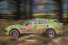 Upcoming Aston Martin SUV Officially Named DBX, Spotted Doing Off-Roading Action