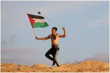 Remember Photo of Shirtless Flagbearer from Palestine? He May Have Been Shot by Israeli Forces