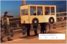 Watch: Some Russians Disguised Themselves as a 'Human Bus' to Cross Vehicles-Only Bridge