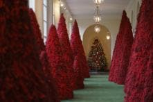 This Christmas, Melania Trump's Red Topiary Trees a Hit at White House Parties