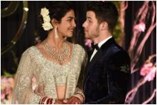 Priyanka Chopra-Nick Jonas Look Dreamy in their Reception Outfits