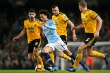 Manchester City Ease Past 10-man Wolves to Cut Gap at Top