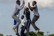At Dawn, a Township Road in Zimbabwe Turns into a Fitness Club