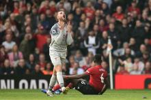Liverpool Go Top After Stalemate at Injury-hit United