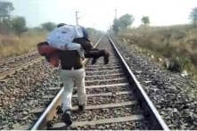 MP Cop Carries Injured Man on Shoulder for 1.5 Km to Save His Life After Fall from Train