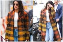 Priyanka Chopra Flashes Belly Ring While Sporting Crop Top & Chequered Coat