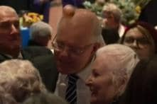 Australian PM Scott Morrison Egged on Head by Woman While Campaigning in Albury