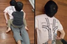 Tired Japanese Engineer Designs Unique T-Shirt to Get Back Massage from Son