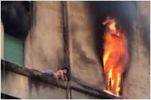 Watch: Man Rescued After Lying for 30 Minutes on Ledge of Burning Building in Rome