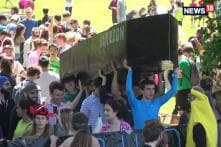 Cambridge University Students Celebrate End Of Exams With Annual Cardboard Boat Race