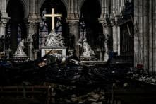 In First Service after Fire in April, Worshippers in Hard Hats to Attend Mass at Notre Dame in Paris