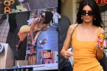 Kendall Jenner's Photos of Outfit Matching Coke Can Puzzle Fans