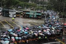Hong Kong Tense as Weekend of Protests Begins With Teachers' Rally in Rain