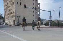 'This is 2019, Not 1819': Outrage after US Cops on Horses Lead Afro-American with 'Rope'