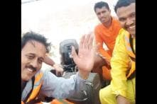 Against a Grim, Flooded Landscape, Maharashtra Min Sparks Row by Smiling and Waving in Selfie Video