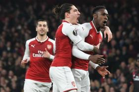 Arsenal and Atletico Madrid Cruise, Borussia Dortmund Bow Out