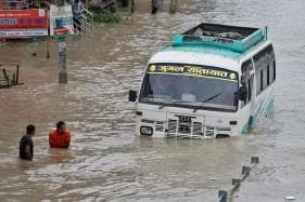 Day in Photos - July 12: Nepal Flooding; PM Modi Inaugurates Dharohar Bhawan; Congress Protest