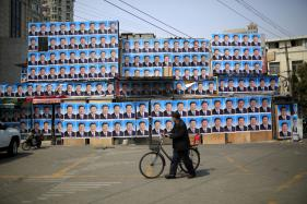 Chinese Woman 'Detained' After Tossing Ink on Xi Jinping Poster: Activists