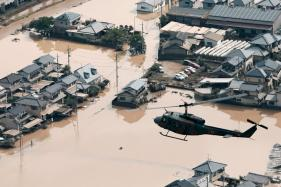 Japan Rescuers Go House to House as Flood Toll Hits 141