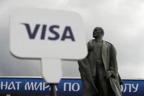 Oh, The Irony: Lenin to be Sandwiched Between Visa, Budweiser at Today's FIFA Final