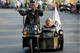 Vespa Enthusiasts Showcase Extreme Mad Max Style Scooters at Indonesian Festival