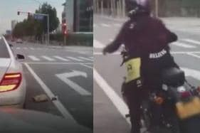 Watch: Chinese Biker Tosses Trash Back into Car. Is This What Indians Should Be Doing?