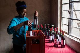 Its Unbelievable! This 27-year-old Rwandan Girl Turns Beetroot into Red Wine. See Pics