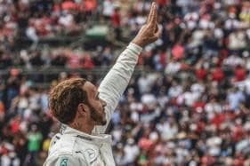 Lewis Hamilton Joins Fangio With 'Surreal' Fifth World Title