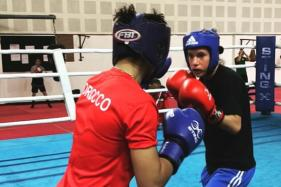 Scribe Turned Boxer Amy Andrew Makes a Winning World Championship Debut