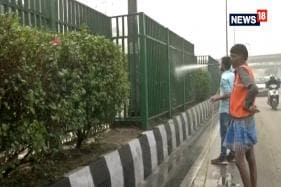 PWD Workers Sprinkle Water To Reduce Dust Pollution