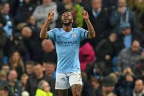 Manchester City Ease Past Huddersfield to Cut Liverpool's Lead