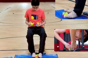 Teenager Solves Three Rubik's Cubes With His Hands and Feet Simultaneously, Sets World Record