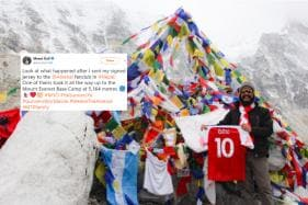 Arsenal Fan Scales New Heights, Takes Signed Mesut Özil Jersey to Mount Everest