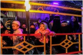 Cleaning Graves, Shared Meals and Torch-lit Parades: Indonesia Muslims Welcome Ramadan