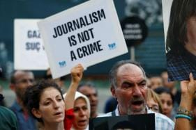 UK Bars Russian Media From Conference Alleging 'Active Role' in Spreading Disinformation