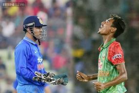 Dhoni, Mustafizur fined over shoving incident in first ODI