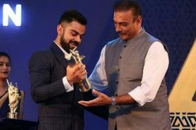 Virat Kohli Receives Polly Umrigar Trophy at BCCI Awards Function