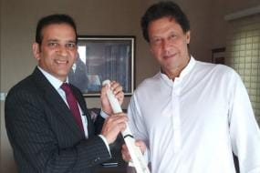 Imran Khan Presented With Bat Signed by Indian Cricketers