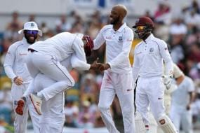Chase Picks Eight as Windies Crush England in First Test