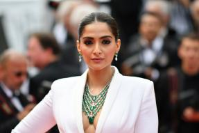 Sonam Kapoor Soars High in White Tuxedo with 2-Metre Train & 115 Carat Emerald Necklace